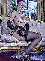 Dazzling hottie in burlesque style outfit with gloves and classy stockings