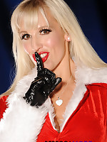 Rebecca More has an early Christmas surprise for you, as she strips out of her Miss Santa outfit and shows off her hot nylon lingerie