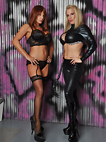 Rebecca poses with guest Carly in their rubber and leather outfits.